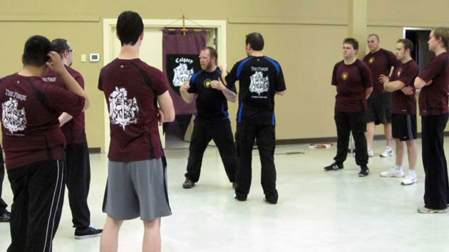 Boxing Instruction: Tim (left) and Mark (right) takes defensive boxing stance.