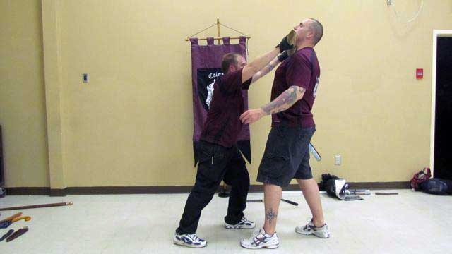 Half-swording technique: finish with an upper strike to the throat holding the2x4 with both hands.